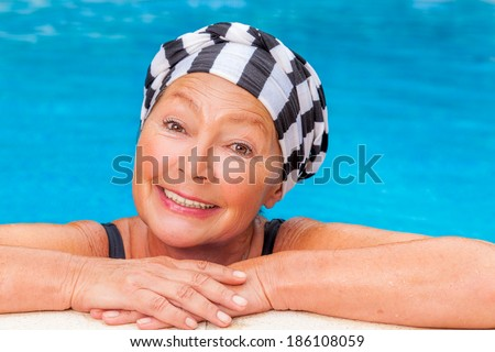 female senior workout smiling camera - stock photo