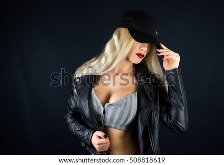 Female sexy breast / Beautiful fashion sexual slim body of woman in studio / Big woman's breasts in black leather jacket / hot sexy blonde girl, mafia glamour bandit gangster mafia style new
