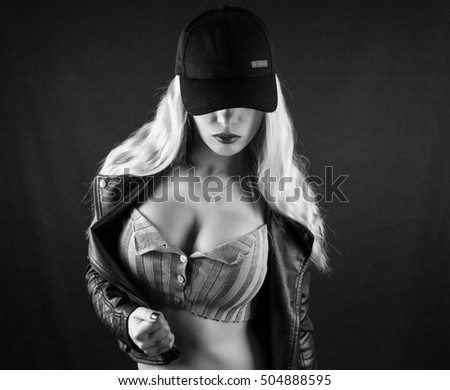 Female sexy breast / Beautiful slim body of woman in studio / Beautiful big woman's breasts in blue jeans jacket / hot sexy blonde girl / mafia girl limited black bandit gangster mafia style edition