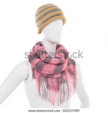 female shirt in Striped Wool Hat with scarf on mannequin - stock photo