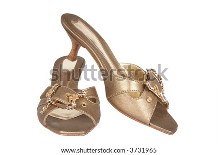 Female shoes of gold color on a white background