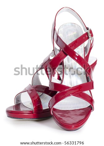 Female shoes on a high heel made of a red varnish leather on white background