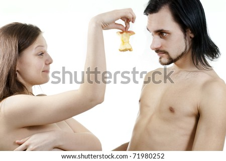 female showing a bit of apple to her boyfriend - stock photo