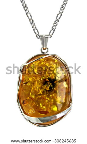 Female silver pendant with amber inset - stock photo
