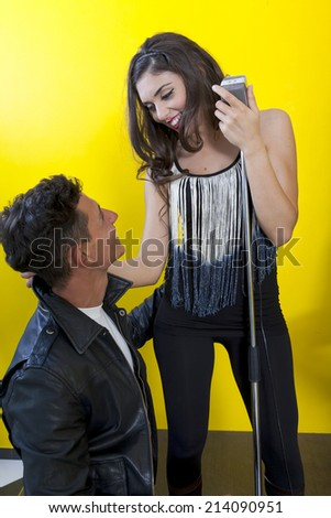 female singer and his fan - stock photo