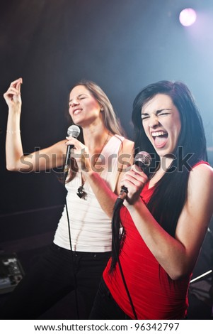 Female singers performing