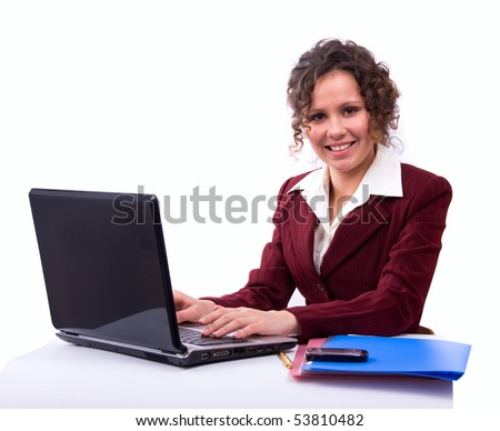 Female sitting with a laptop. Happy young businesswoman sitting on chair with laptop on lap looking at camera. Smiling business woman working on computer. - stock photo
