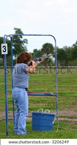 female skeet trap shooter - stock photo