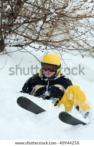 Female skier coming down a wild slope with deep snow - stock photo