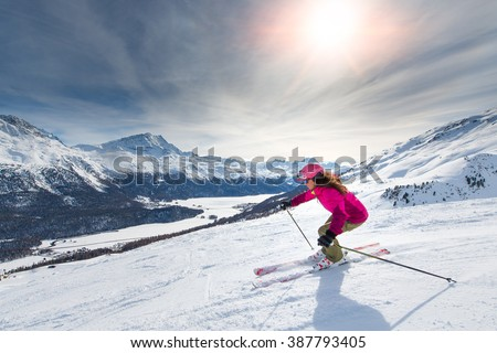 Female skier in downhill slope - stock photo