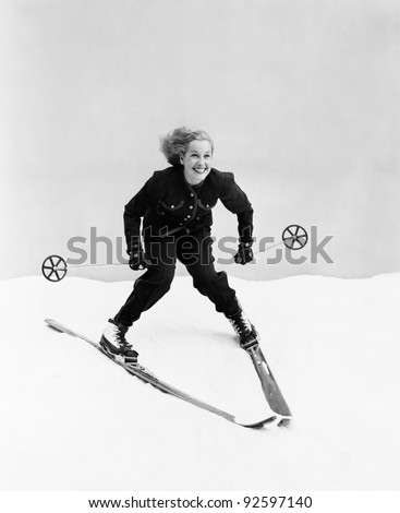 Female skier skiing downhill - stock photo