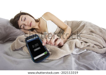 female snoozing modern cell phone alarm clock - stock photo