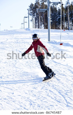 Female snowboarder on the snowhill. - stock photo