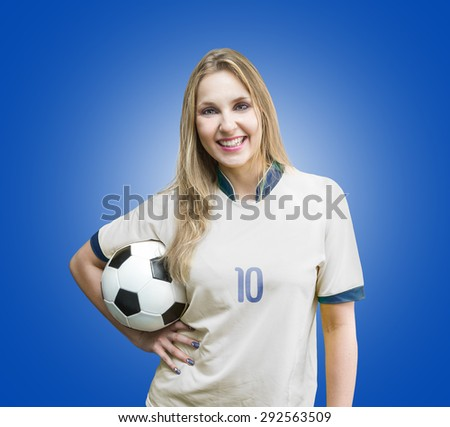 Female soccer fan on white and blue uniform on blue background - stock photo