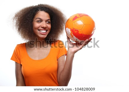 Female soccer fan with a ball - stock photo