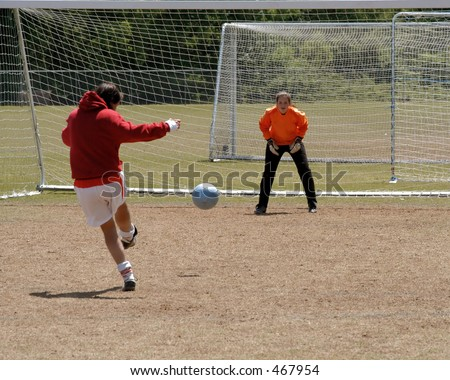 Female soccer keeper prepares for save - stock photo