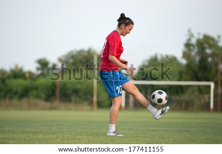 female soccer player on the field - stock photo