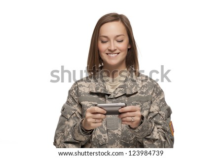 Female Soldier reading text messages - stock photo