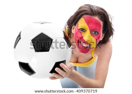 female spanish painted soccer fan smiling, football in her hands, isolated on white - stock photo