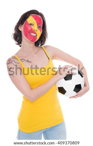 female spanish painted soccer fan smiling, football under her arm,  isolated on white - stock photo