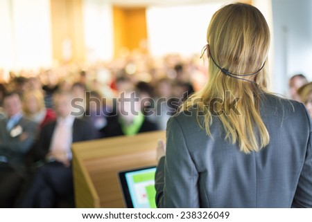 Female speaker at Business Conference and Presentation. Audience at the conference hall. Business and Entrepreneurship. Business woman. - stock photo