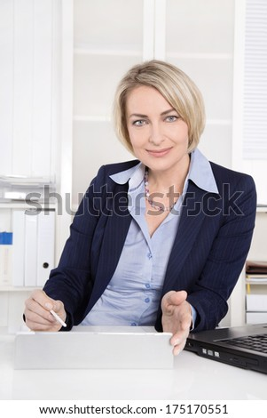 Female specialist for finance - businesswoman sitting in her office.