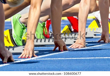 Female sprinters in start block