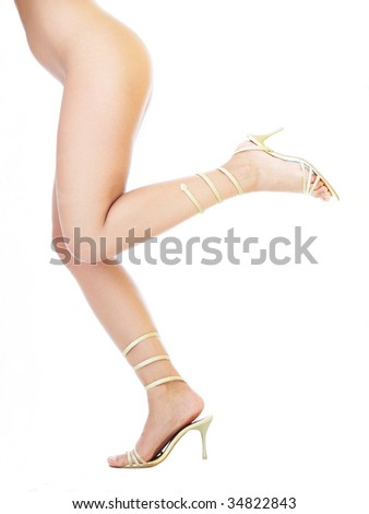 Female standing in golden high heels isolated on white background