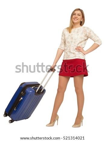 female standing with blue suitcase isolated on white background