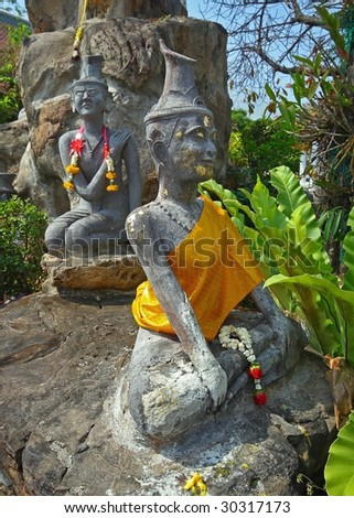 female statue at wat po bangkok - stock photo