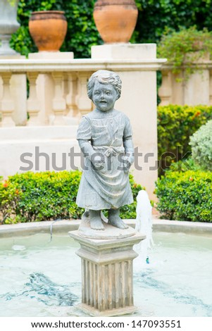 Female statue made of marble. Decorative gardens - stock photo