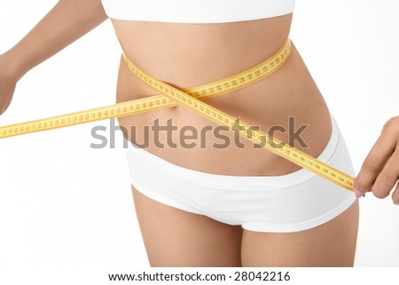 Female stomach with the measuring band, isolated