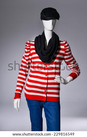 female striped shirt clothing in hat on mannequin-gray background - stock photo