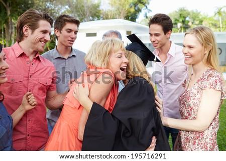 Female Student And Family Celebrating Graduation - stock photo