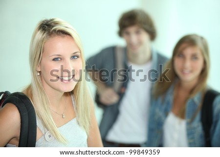 Female student and her friends - stock photo