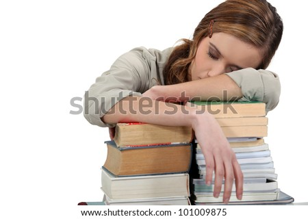 Female student asleep on her books - stock photo