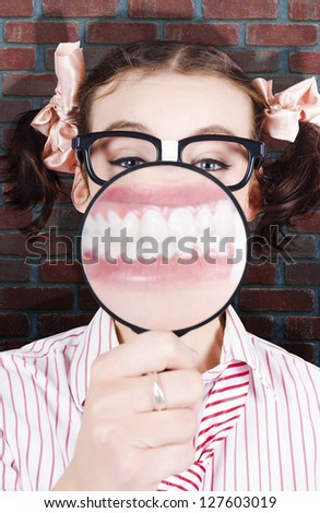 Female Student At The Dentist Showing Big White Teeth With A Big Smile In A Depiction Of School Dental Care - stock photo