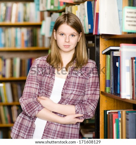 Female student  at the university library - stock photo