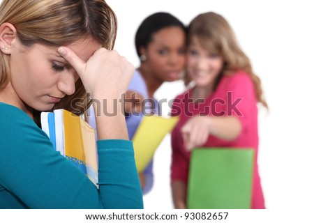Female student being bullied - stock photo
