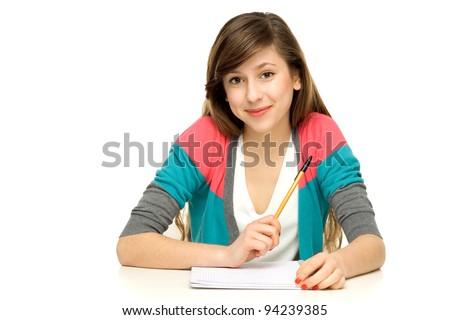 Female student doing homework - stock photo