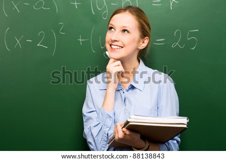 Female Student Doing Math on Chalkboard