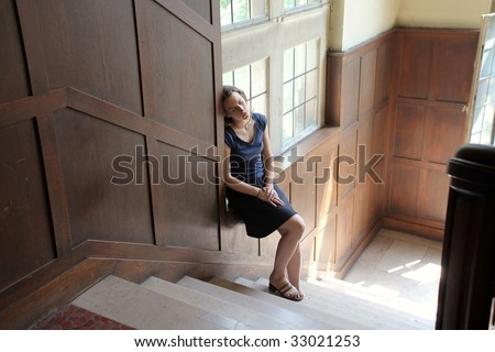 female student falling asleep in an old school interior