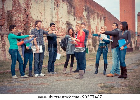 Female Student get Mobbed by the Group - stock photo