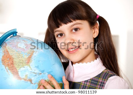 female student holding a Globe - stock photo