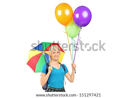 Female student holding an umbrella and balloons isolated against white background
