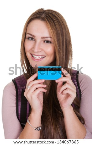 Female Student Holding Credit Card Over White Background - stock photo