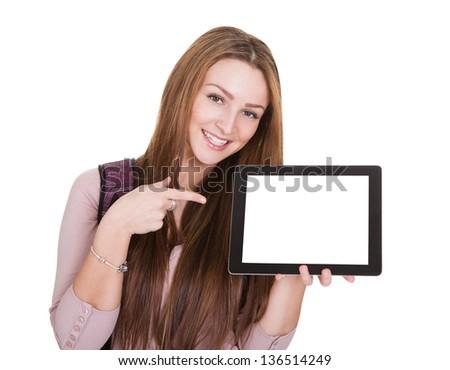Female Student Holding Digital Tablet Over White Background - stock photo