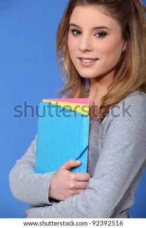 Female student holding folder - stock photo