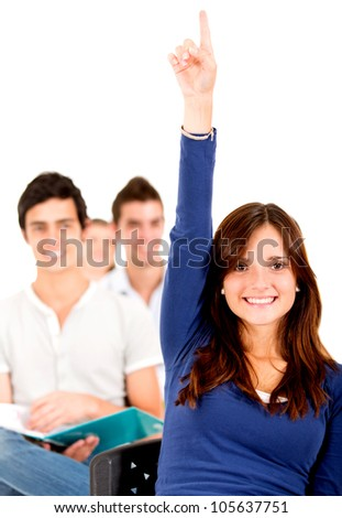 Female student in class raising hand - isolated over a white background - stock photo