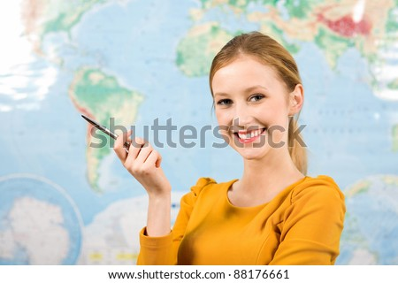 Female student in front of world map - stock photo